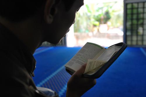 Boy reading Quran