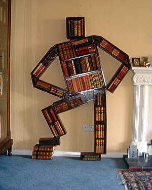 bookcase shaped in outline of a man