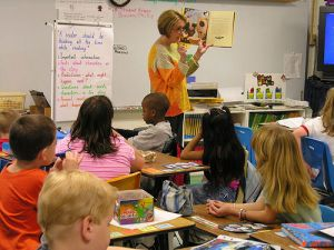 Teacher reading aloud to class Flickr CC
