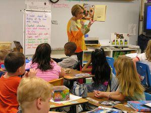 Teacher reading aloud to class Flickr CC